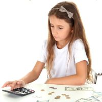 7 Real Life Tips for Teaching Kids About Money